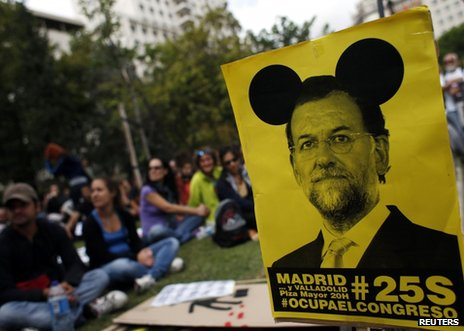 A placard could be seen mocking Spanish Prime Minister Mariano Rajoy