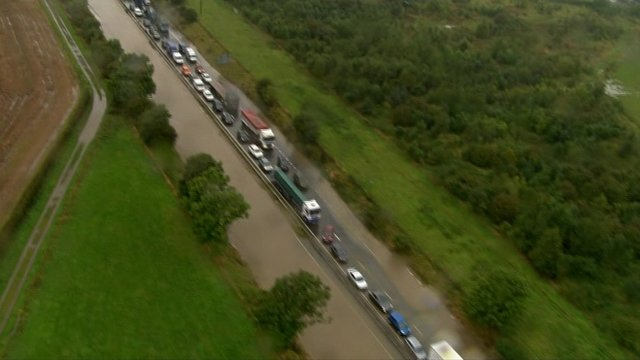 Cars stuck on the flooded A1