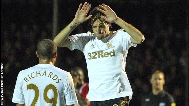 Miguel Michu celebrates Swansea's opener