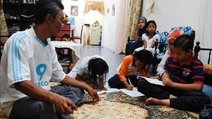 Anuar bin Mohd Jassin and family in their free home
