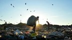 Young children collect waste at a landfill in Managua