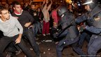 Riot police clash with protesters in Neptuno Square during demonstrations outside the Spanish parliament