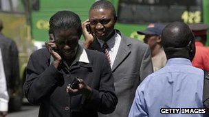 Kenyans using mobile phones in Nairobi