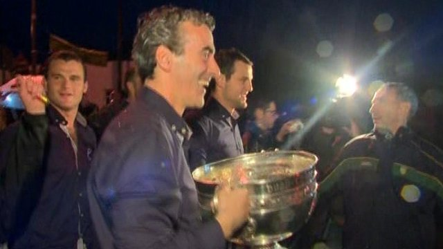 Jim McGuinness and Michael Murphy walk the Sam Maguire Cup across the border into county Donegal at Pettigo