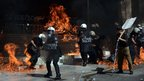 Riot police fighting fires