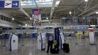 Man standing in deserted Athens' Eleftherios Venizelos airport