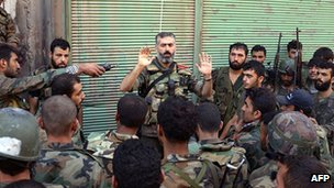 Rebel soldiers listen to rebel commander in Aleppo, Syria