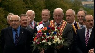 Orangemen and MLAs lay wreath at Sir Edward Carson's statue at Stormont
