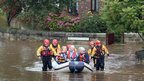 Rescuers take residents from a flooded complex for senior citizens in Boroughbridge, North Yorkshire.