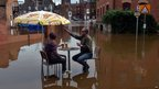 Drinkers in York amid floodwaters