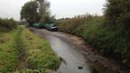 Barges stranded in a drained section of the Trent and Mersey canal