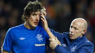 Rangers forward Francisco Sandaza receives treatment on an injury