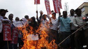 Protestors burn an effigy representing India&quot;s ruling United Progressive Alliance during a nationwide strike in Hyderabad, India, Thursday, Sept. 20, 2012.