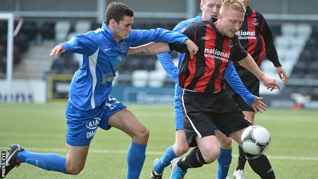 Ballinamallard&#039;s Stuart Hutchinson in action against Chris Morrow of Crusaders