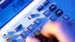 Man using calculator