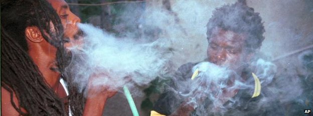 Rastafarians smoke marijuana in Kingston, Jamaica - August 1999