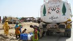 Fresh  water being distributed to flood victims in Balochistan