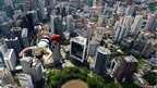 Base jumper Anton Chervyakov from Russia leaps from the top of the 421m Kuala Lumpur Tower
