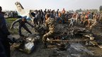 Nepalese police salvaging debris at the crash site of a Sita Air airplane near Kathmandu, 28 September 2012