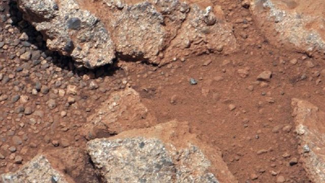 Image provided by NASA shows a Martian rock outcrop near the landing site of the rover Curiosity, thought to be the site of an ancient streambed.