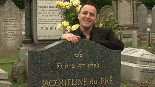 Benjamin Till with the gravestone of Jacqueline du Pre