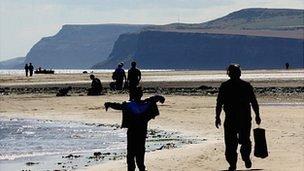 People walking on Redcar beach