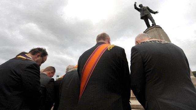 Orange Men at Carson's statue