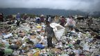 A young boy collects waste at a landfill on the outskirts of Tegucigalpa