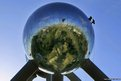Workers stand on one of the spheres of Brussels' Atomium, during a site cleaning which will continue for a month.