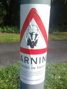 Anti-badger cull poster on a road sign