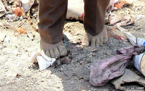Barefoot boy in La Joya rubbish dump, Granada, Nicaragua