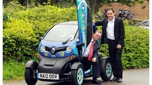 Student and boss with Renault Twizy vehicle