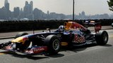 Former Red Bull Racing Formula 1 driver David Coulthard drives the Red Bull running show car for a video shoot on August 15 2012 in Weehawken