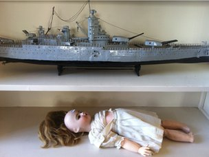 A child's doll and a model battleship in the former residence of President Giscard d'Estaing
