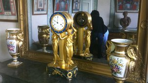 A bronze clock up for auction in the former home of  President Giscard d'Estaing