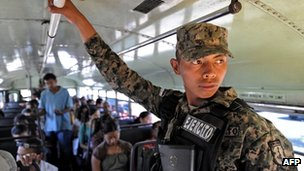 Honduran soldier riding a public bus in Tegucigalpa