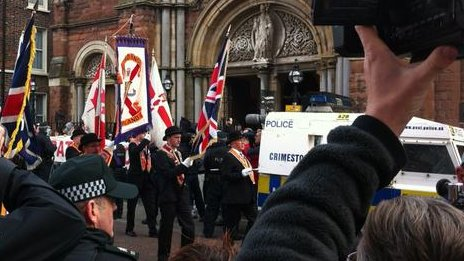 The parade has passed St Patrick's Church on Donegall Street