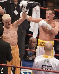 Alex Arthur raises Ricky Burns's arm after he had beaten the Coatbridge fighter in 2006