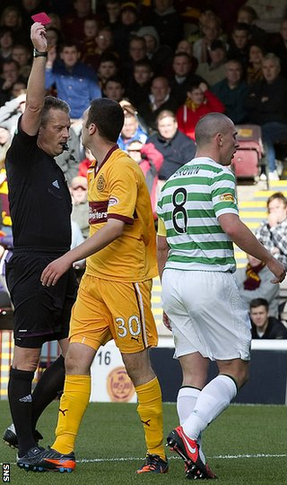 Adam Cummins is sent off by referee Iain Brines