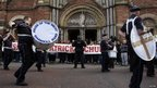 Nationalist residents in north Belfast protest outside St Patrick's Catholic Church