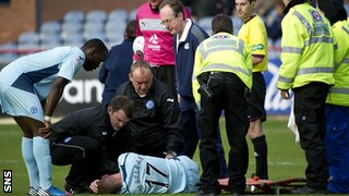 Steven MacLean receives treatment on an injury