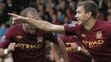 Edin Dzeko celebrates after scoring Manchester City's winner