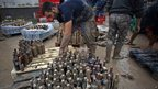 A man sorts muddy bottles in the town of Villanueva del Trabuco, Malaga, southern Spain.