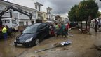 A crane helps to remove cars carried away by flash floods after heavy rain in the town of Villanueva del Rosario, Malaga, southern Spain.
