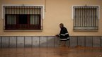 A man walks in a flooded street on September 28, 2012 after heavy rainfalls in Bobadilla, near Malaga, southern Spain.