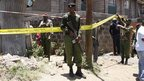 Police secure the area near the scene of an explosion. Kenyan police say they have arrested three suspects following the explosion at a church in Nairobi, Kenya, 30 September