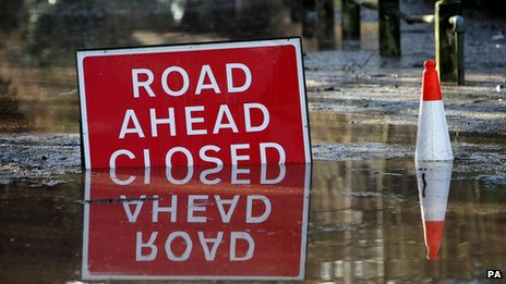 Road closed sign in a flood
