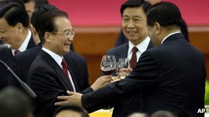 Chinese Premier Wen Jiabao, standing left, makes a toast with high-ranking Chinese officials during a dinner marking the 63rd anniversary of the founding of the People's Republic of China at the Great Hall of the People in Beijing Saturday, 29 September 2012