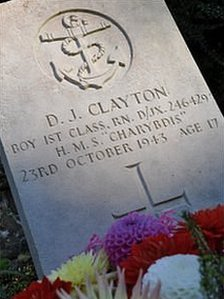Flowers laid at the gravestone of a crew member of HMS Charybdis