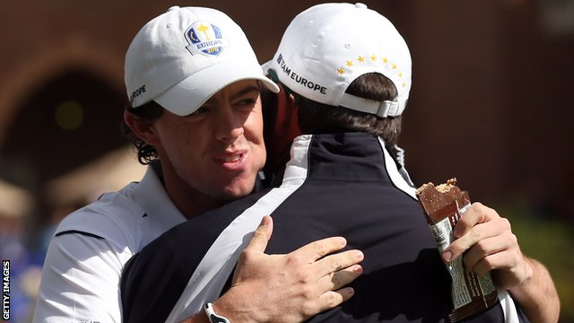 Rory McIlroy embraces European Ryder Cup skipper Jose Maria Olazabal after his late arrival for Sunday&#039;s singles